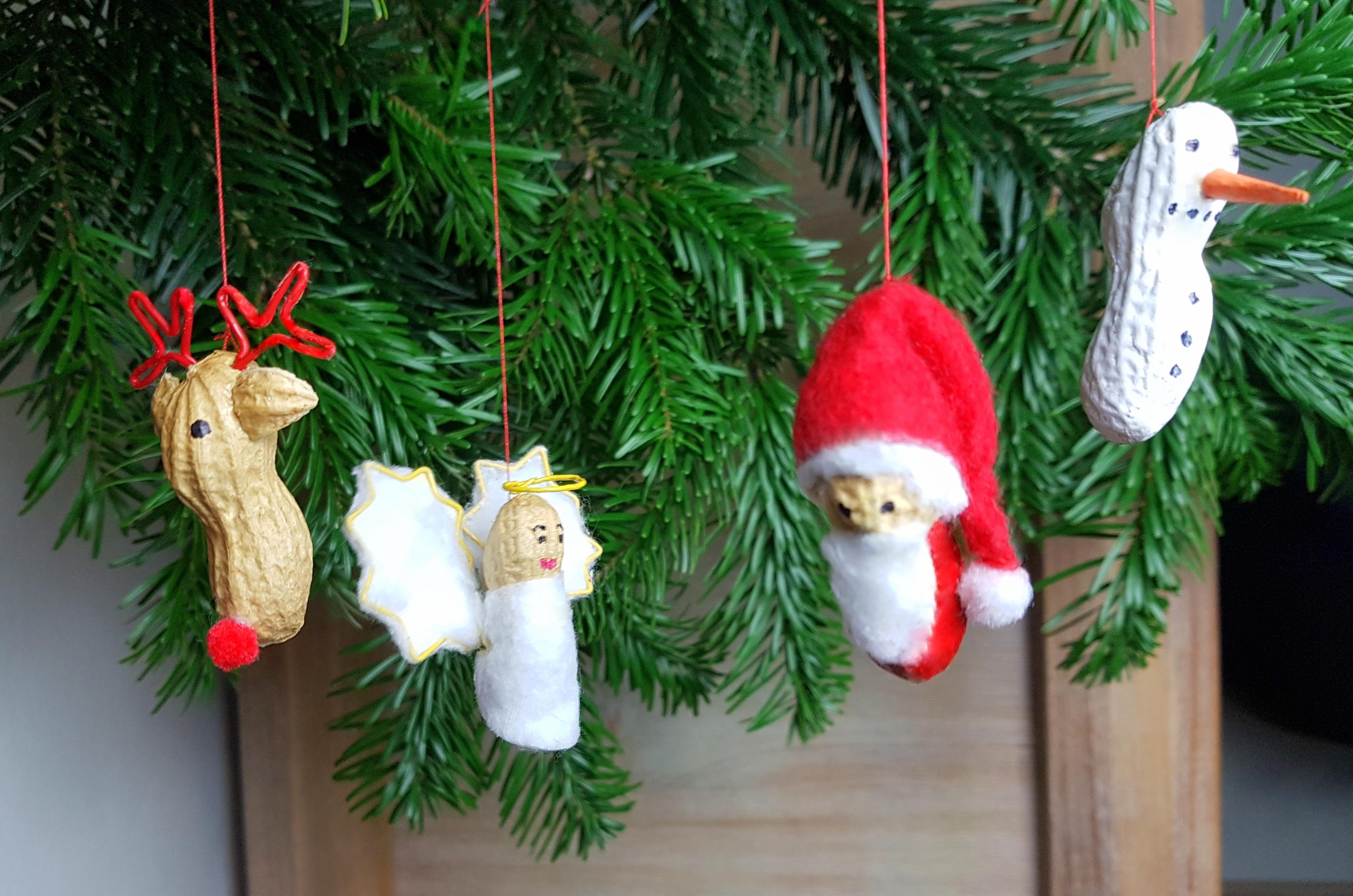 Weihnachtsfiguren aus Erdnüssen basteln Anleitung